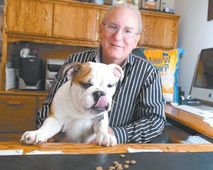 Animals: Joey Herrick in his office at Natural Balance Pet Foods with his 22-week old bulldog, Tyler. Pets are welcome during the workday at the Pacoima company.