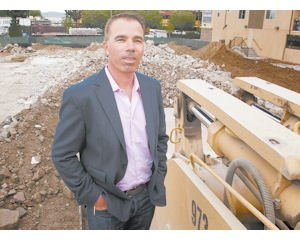 Caption: Developer Shawn Evenhaim at construction site of an 81-unit multi-family building in Canoga Park.