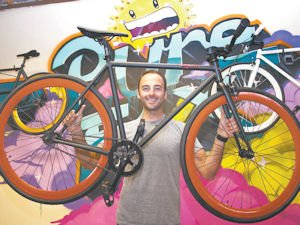 Wheels: Zach Schau with the Echo model fixed-gear bicycle sold by Pure Fix.