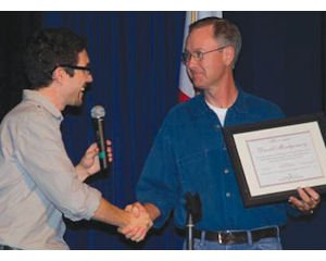 Happy grad: Village of Hope Manager Nathan Bates congratulates Village of Hope graduate David Montgomery