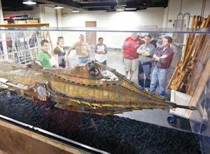 """Movies: Workers prepare to move the Nautilus model from the 1954 film """"20,000 Leagues Under the Sea"""" at the Ronald Reagan Library in Simi Valley."""