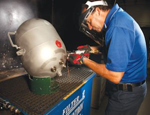 Build: A worker at Pacific Scientific HTL works on a fire suppression tank.The company, part of Meggitt Safety Systems, will move its operations to Simi Valley in 2013.