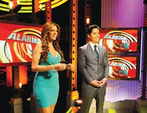 Viewers: Hosts Liana Gretel (left) and Jorge Antolin on the set of Alarma TV.