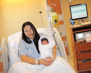 Birth: New mom Anita Rodriguez, 23, with her new baby, Nevaeh Hazelle Zamara.