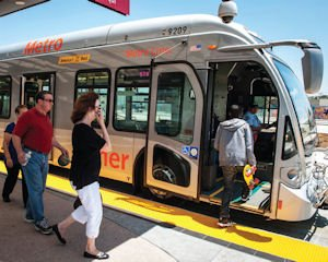 Riders: Passengers board the Orange Line bus at the new station in Chatsworth.