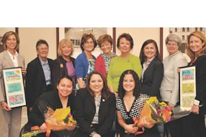 Day of Gratitude: Girls Inc. alumnae and luncheon speakers Helen Luna and Julieth Zapata flank the organization's chief executive Lucy Santana (front row); Kimberly Bernatz of First American Trust, Girls Inc. directors Mary Sue Allen, Susan Wampler, Gena Reed, Pam Policano, Jane Ballback and Elizabeth Weldon, former director Elaine Levin, and Vicki Booth of the Ueberroth Family Foundation (back row)