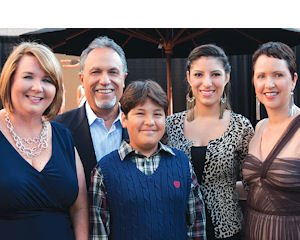 Wooden Floor fundraiser: Organization's Executive Director's Dawn S. Reese, Chairman Ernesto Vasquez, program participants Jafeth Orozco and Valeria Herrera, and Artistic Director Melanie Rios Glaser