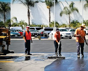 Auto: Workers repave the lot at the former Galpin Motors Saturn dealership, which soon will be the future site of Galpin Volkswagen.