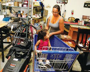Shop: Tina Caro-Ponce and her 3-year-old daughter, Isabella, of Chatsworth shopped at the new Habitat for Humanity ReStore on a recent afternoon.