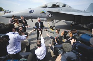 U.S. Navy Secretary Ray Mabus speaks with the media about the supersonic flight of the 'Green Hornet' on Earth Day 2010 at a naval base in Maryland. The Green Hornet is an F/A-18 Super Hornet jet that flew using a 50-50 mix of biofuel and jet fuel, and is part of the military's research into using alternative fuels.