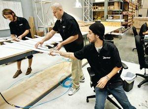 Production: Joe Sepulveda (far right) assembles fluorescent shaped LED bulbs at Seesmart, a LED light bulb manufacturer, on Oct. 17, 2011.