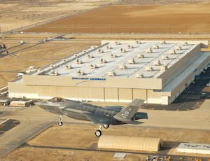 Fly: An F-35 Lighting II flies over the Northrop Grumman Aerospace Systems assembly and maintenance facility in Palmdale.