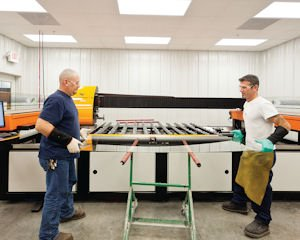 Glass: Anthony International employees working on a refrigerator door at the Sylmar factory. The doors are used in grocery stores, hospitals and private homes.