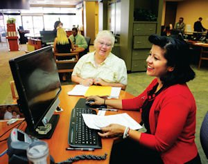 Mortgage: Financial Service Officer Nancy Soto (right) assists Faye Cohill with a home loan at Logix Federal Credit Union.