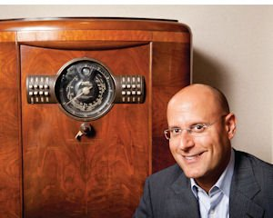 Old and New: Neal Schore, co-founder and CEO of Triton Digital, with antique radio in the company's Sherman Oaks office.