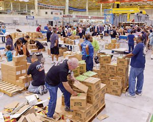 Handled With Care: Workers assemble packages in Palmdale for service members.