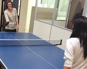 Bascom Group: Julie Schoenbachler and Michelle Khuu take a break with pingpong