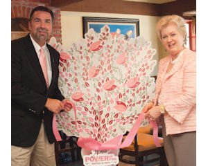 Giving Tree: Mears and National Breast Cancer Foundation founder and Chief Executive Janelle Hail tie a ribbon on a Giving Tree at the Mimi's Café in Irvine