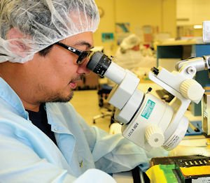 High Tech: Technician works on cells in Sylmar.