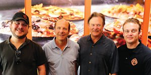 Pie Makers: From left, Jeff Zuckerman, Irv Zuckerman, Rodney Eckerman and Nicholas Eckerman at Pizza Rev.