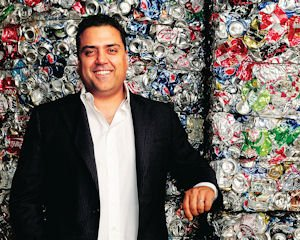 Crushing the Competition: Sepand Samzadeh, co-chief executive of Valley Recycling, with aluminum cans at company's Chatsworth facility.