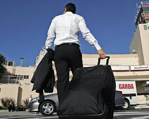 Lugging It: Traveler at Burbank airport.