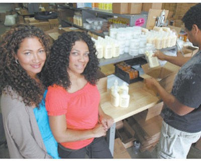 Beauty Secrets: Mixed Chicks Wendi Levy, left, and Kim Etheredge at warehouse.