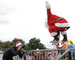 Skateboarding Santa: holiday festival, shoe give away at etnies Skatepark in Lake Forest