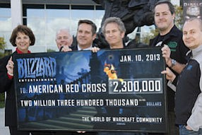 Janet Whitcomb, American Red Cross of Orange County COO; Bill Blanning, Red Cross board member; Donald Voss, Red Cross board member; Mike Morhaime, CEO and cofounder of Blizzard Entertainment; J. Allen Brack, production director for World of Warcraft, Blizzard Entertainment; and Tom Chilton, game director for World of Warcraft