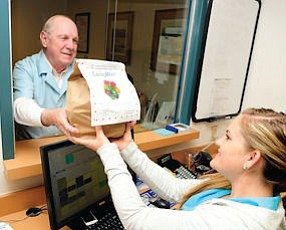 Bagging It: Volunteer David Kennedy delivers fruit to the radiology department.