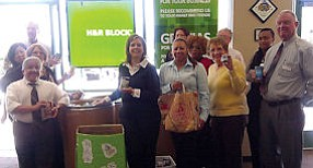 Not So Taxing: Office managers near food bin at H&R Block's Lancaster office.