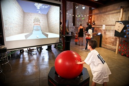 A child plays with a STEAM Carnival game at the Brewery Art Walk in downtown Los Angeles last weekend.