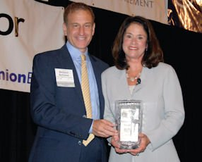 2012 Women in Business Awards: Business Journal Publisher Richard Reisman and Kimberly Cripe, CHOC Children's chief executive. This year's event will take place June 4 at the Hyatt Regency Irvine.