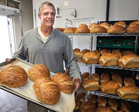 Fresh Baked: Abby Franke with bread just out of oven at his Abby's Millstone Baking Co.