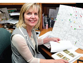 All Plotted Out: Paula Wilson, CEO of Valley Community Clinic, with map showing location of new facility.