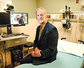 Dr. David Guss is chair of the Department of Emergency Medicine at UC San Diego School of Medicine and principal investigator for the university's telemedicine program. The UCSD program, which has been in effect for about six months, keeps a physician on call to remotely triage patients when the waiting room is at capacity.