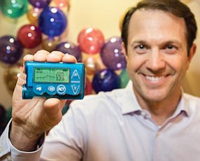 High Tech: Medtronic Chief Technology Officer John Mastrototaro holds advanced Threshold Suspend insulin pump at company's Northridge lab.