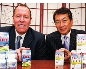 Salesmen: Anthony Raissen, left, and Tony Hatori with supplement products, Okinawa Life and NutriDiet.