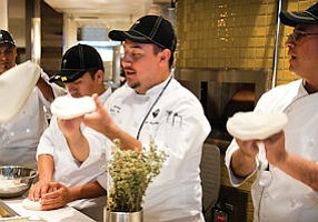 Canoga Park: Chefs in action at the new California Pizza Kitchen outlet.