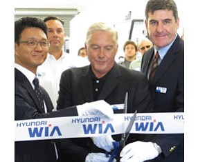 Cypress center: President I.C. Lee, sales manager Craig Krzyston and Executive Vice President Peter Histed cut ribbon on showroom, training facility