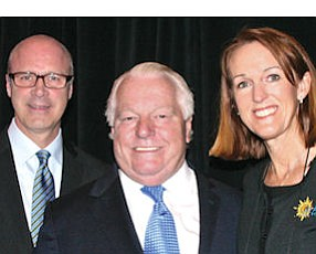 Tourism experts: left to right, Jay Burress, president-chief executive of the Anaheim/Orange County Visitor & Convention Bureau; Roger Dow, president-chief executive of U.S. Travel Association; Ann Gallaugher, vice president of tourism development at the convention bureau