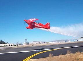 Aerobatic pilot Sean Tucker performs during the dedication of the refurbished runway at Van Nuys Airport