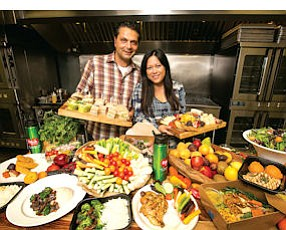 Quite the Spread: FreshLunches founders Alan Razzaghi, left, and wife Uyen-Uyen Tong, with a selection of lunch foods.