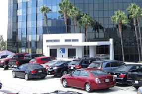Chock full: direct-to-consumer lender Greenlight has more employees than parking spaces at Irvine headquarters these days
