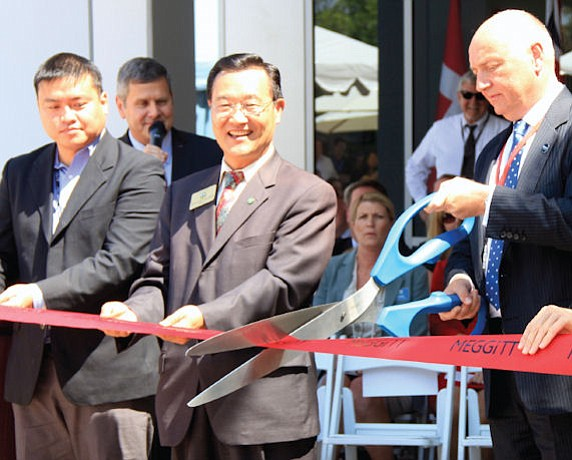 Official opening: site manager David Lin and Irvine Mayor Steven Choi with Meggitt Sensing Systems President Peter Huber at ribbon cutting last month