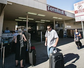 Loaded Down: Travelers with their baggage last week outside aging terminal at Burbank Bob Hope Airport.