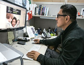 Layout: Senior graphic designer Edgar Abarca works on book cover at Sage.