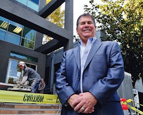 Soft Landing: Hank Cohen outside offices of new employer, InterMedia Group.