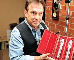 Frontman: Rick Perrotta, president of Royer Labs, displays company's microphones in case