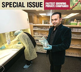 Bagging It: Avetis 'Avo' Minasyan holds infusion bag at TNH Pharmacy II in Van Nuys.